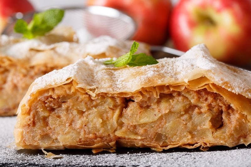 strudel, apple, pie, sugar, sweet, bakery, food, homemade, fruit, tasty, cake, dessert, roll, pastry, traditional, baked, winter, stuffed, cinnamon, spice, background, cuisine, slice, delicious, apfelstrudel, sieve, powdered, mint, closeup, horizontal, rustic, filling, wooden, fresh, recipe, autumn, crust, table, portion, raisin, meal, gourmet, german, austrian, sliced, powder, black, macro, nuts, raisins